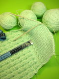 Green knitting Stock Images