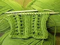 Green knitting. Threads and needle for backgrounds Stock Images
