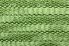 Green knitting background horizontal stripes royalty free stock images