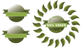 Green Label with Banner Glossy Vegan. Glossy label button with banner and leaves around 100 percent organic food all natural vegan label Stock Photo