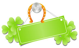 Green label with horseshoe and shamrock Royalty Free Stock Photos