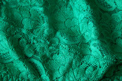 Green lace material close up side lighting Royalty Free Stock Photo