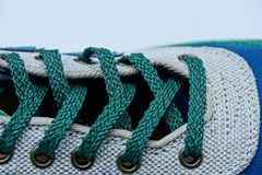 Green shoelaces on a colored leather boot stock images
