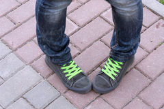 Green laces shoes. Green laces threaded through the black shoes Royalty Free Stock Photography