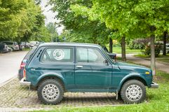 Green Lada Niva 4x4 off road car parked on the street. Novi Sad, Serbia. July - 12. 2018. Green Lada Niva 4x4 off road car parked on the street. Editorial image Royalty Free Stock Photos