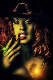 Green lady. Close-up portrait of a fairy wicked witch in the wizarding lair. Magic. Halloween Royalty Free Stock Photography