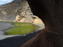 Green lagoon 001. Green lagoon a touristical highlight at Lanzarote, one of the Canary islands. Close to the atlantic ocean it is a mixture of salt and Royalty Free Stock Photo
