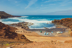 Green Lagoon at El Golfo with fishing boats on the beach, Lanzarote Royalty Free Stock Photography