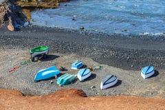 Green Lagoon at El Golfo with fishing boats on the beach, Lanzarote Royalty Free Stock Photos