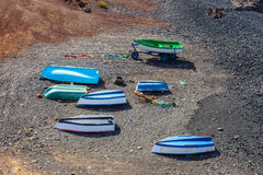 Green Lagoon at El Golfo with fishing boats on the beach, Lanzarote Stock Images