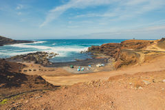Green Lagoon at El Golfo with fishing boats on the beach, Lanzarote Royalty Free Stock Photo