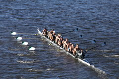 Green Lake Crew races in the Head of Charles Regatta Men`s Youth Eight Stock Images