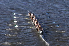 Green Lake Crew races in the Head of Charles Regatta Men`s Youth Eight. BOSTON - OCTOBER 23, 2016: Green Lake Crew races in the Head of Charles Regatta Men`s Royalty Free Stock Photos