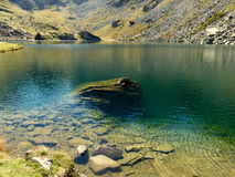 The green Lake Fiorenza Piedmont Italy Europe. Clear waters of Lake Fiorenza at the foot of Monviso mountain Piedmont Italy Europe Stock Photo