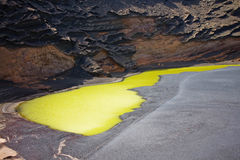 Green lake inside a volcanic crater Royalty Free Stock Photo