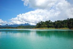 Green lake and mountain. This green lake and mountain are in dam.this lake is in surat south of thailand Stock Photos