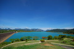 Green lake and mountain. This green lake is in south of thailand.it is a large and silent place Royalty Free Stock Image