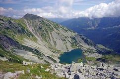 Green lake in mountains Stock Photos