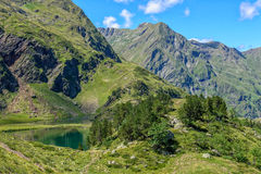 Green lake near Luchon in the Pyrenees mountains Royalty Free Stock Photo