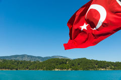 Green Lake. Oymapinar. Turkish flag Royalty Free Stock Photos