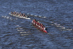 Green Lake top  Arlington Belmont Crew bottom races in the Head of Charles Regatta Men`s Youth Eights Stock Image