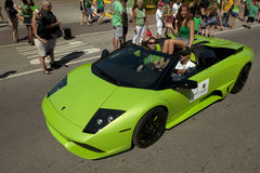 Green Lamborghini in Saint Patrick's Day Parade Stock Photo