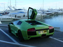 Green Lamborghini and yacht in Puerto Banus, Spain Royalty Free Stock Images