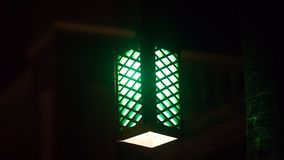 Green Lamp hanging from Ceiling stock images