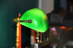 Green Lamp Isolated on the Old Office Background. Green glass Lamp Isolated on the Old Office Background with a pull switch Stock Photo