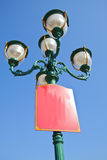 Green lamp under blue sky Stock Photography