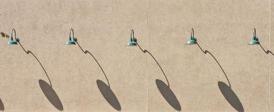 Green Lamps and Shadows on Brown Stucco Wall Royalty Free Stock Photos
