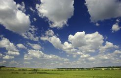 Green landsape with clouds. Summer landsape with a lot of clouds Royalty Free Stock Images
