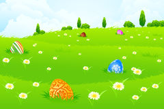 Green Landscape Background with Easter Eggs Stock Photo