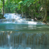 Green landscape and bright waterfall Stock Images