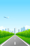 Green landscape with city and road Royalty Free Stock Photo
