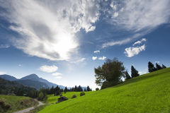 Green landscape with dramatic cloudy sky Stock Image