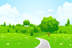 Green Landscape with hill tree road and flowers royalty free stock photos