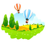 Green Landscape with Hot Air Balloon in the Sky Royalty Free Stock Photos