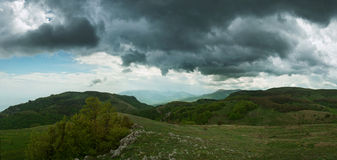 The green landscape. Mountains and the sky green slopes and clouds Stock Photo