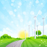 Green Landscape with Wind Power Station Trees and Road Royalty Free Stock Photography