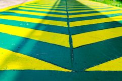 Green lane with yellow line. Green Cycle lane with yellow line stock photography