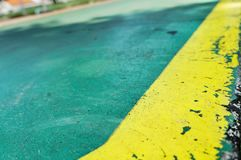 Green lane with yellow line. Green Cycle lane with yellow line royalty free stock images