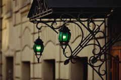 Green lantern at the entrance to the house. vintage street lamp. stock photo