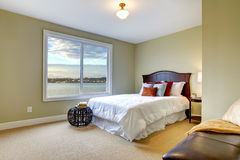 Green large bedroom with white bed and water view. Royalty Free Stock Photography