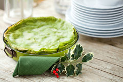Green Lasagna On Christmas Table Stock Photography