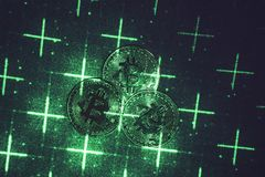Green laser beam and bitcoins stock images