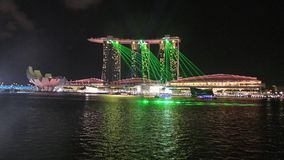 Green Laser Beams  display infront of Marina Sand Bay Royalty Free Stock Photos