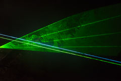 Green laser beams Stock Photo