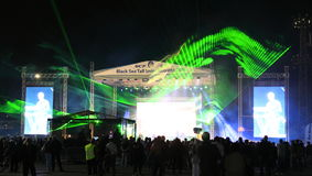 Green laser light night concert stage. Striking green laser lights during the Black Sea Tall Ships Regatta 2016 Varna Bulgaria Royalty Free Stock Photo