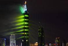 Green lasers give Taipei 101 a Matrix-like atmosphere for the 2017 New Year fireworks and light Royalty Free Stock Images